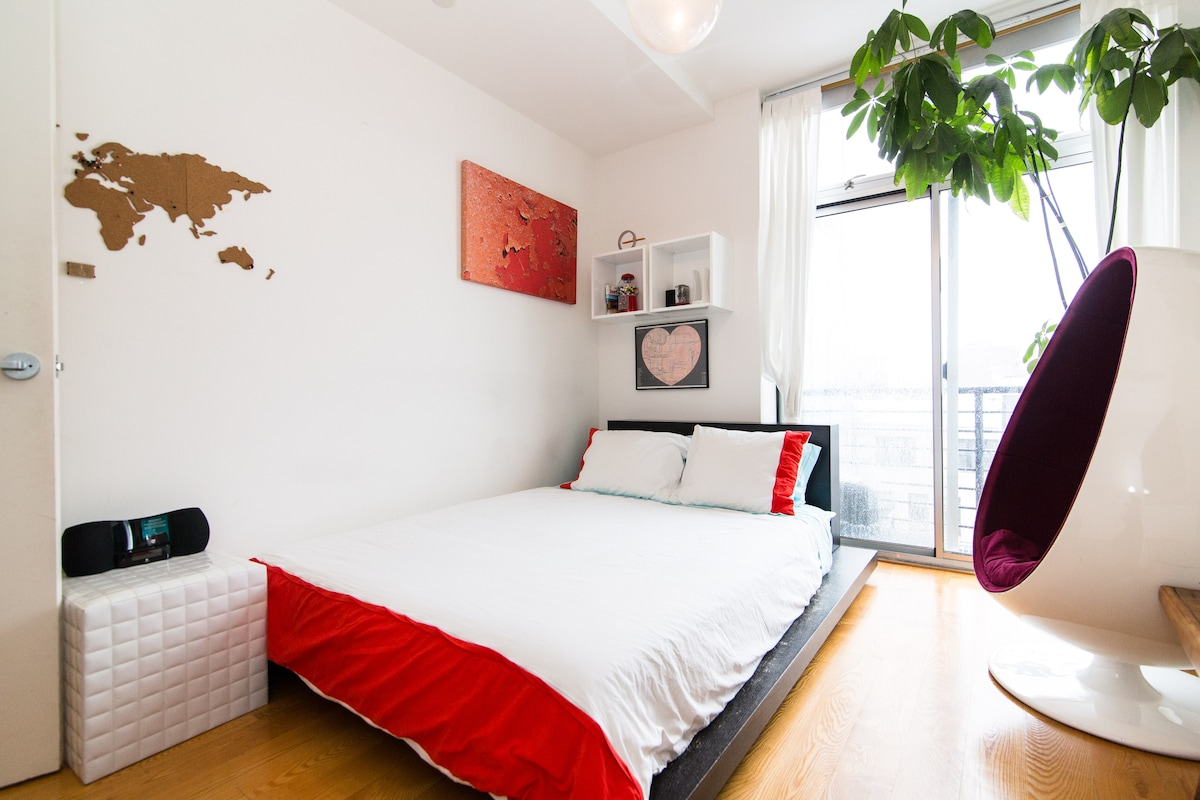 Your bedroom features a Queen-sized bed, private balcony, and an egg chair. Not visible: Huge flatscreen TV w/ Netflix