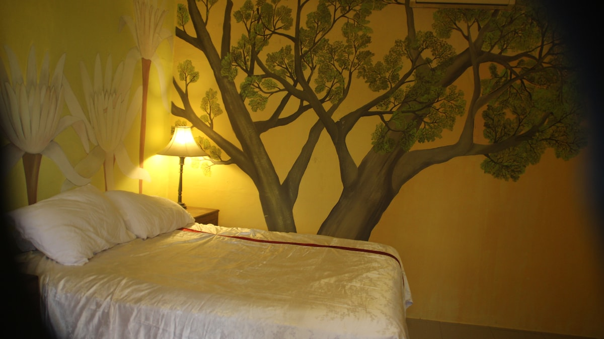 flowers and tree's surround you while you sleep in this quiet air con room.