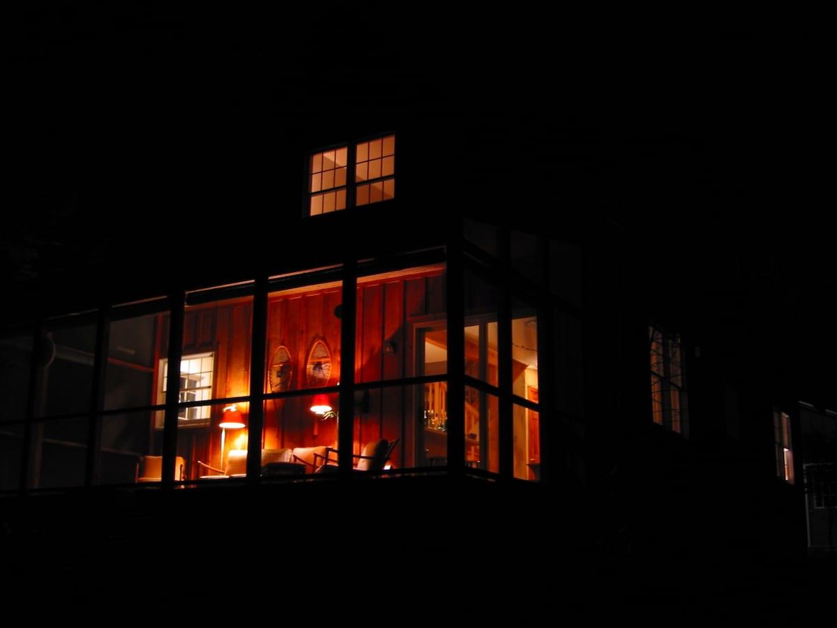 Screen porch at night.
