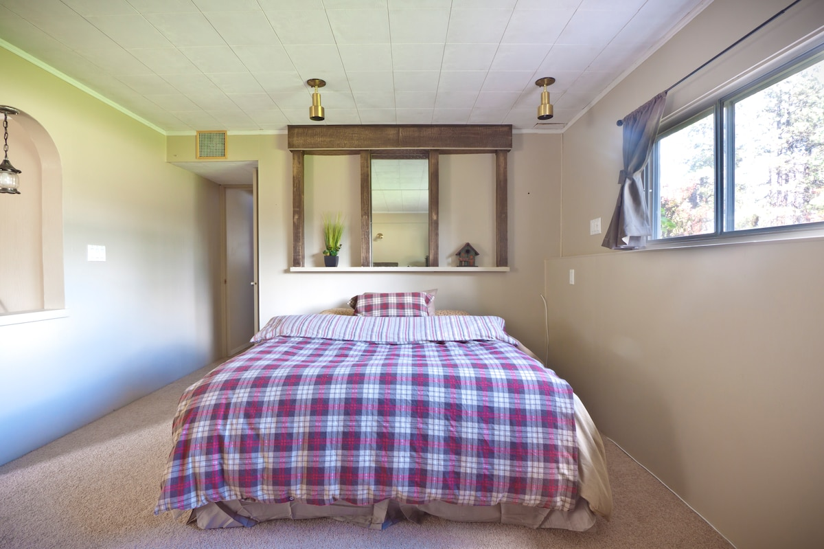 queen bed, lots of natural light, warm and cozy next to the wood stove