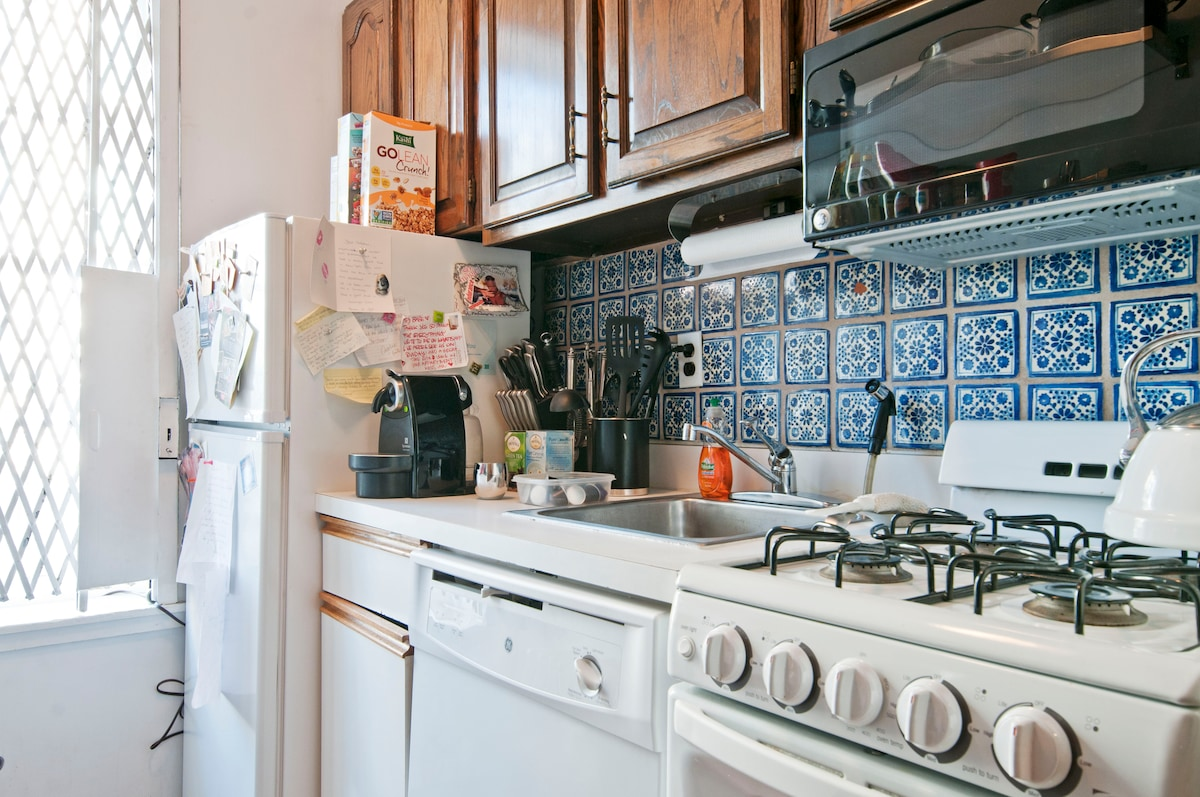 cozy new york kitchen and there is an espresso machine and tea available at ur disposal