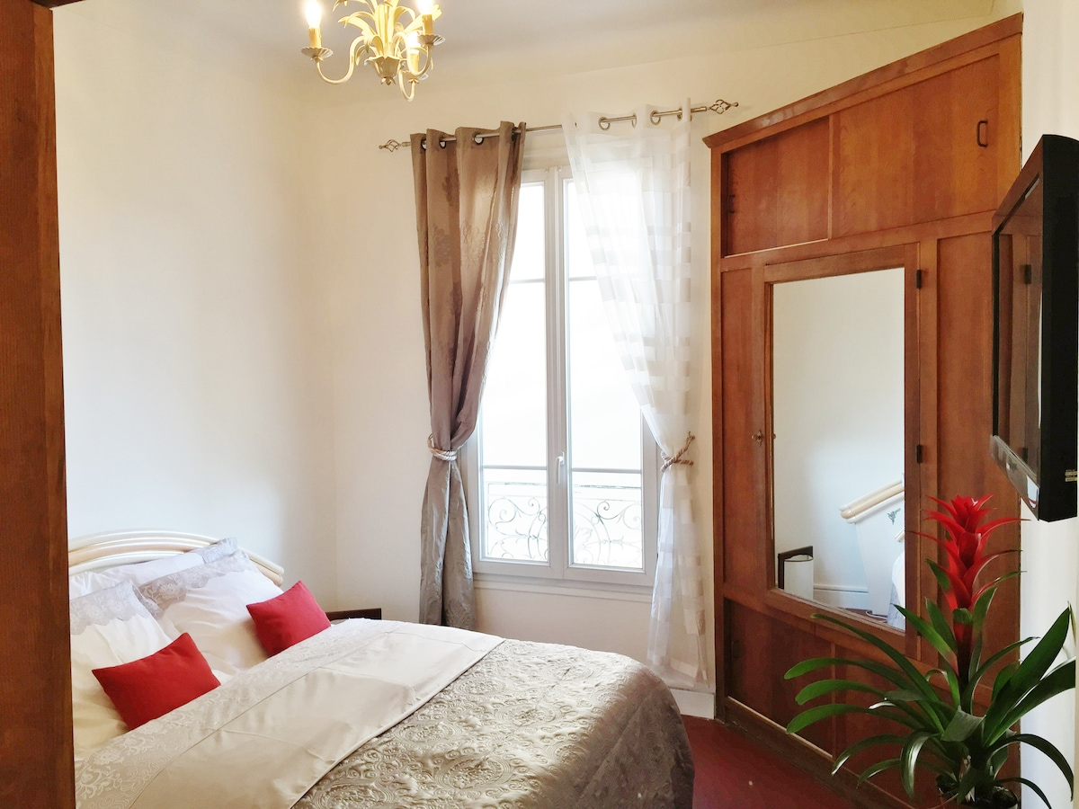 Very big bedroom with television and 2 large wardrobes