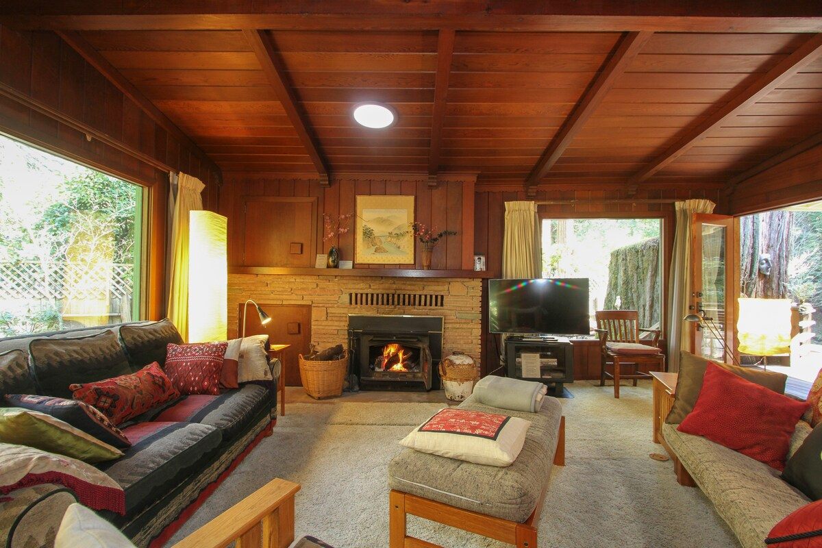 Tastefully decorated with Craftsman, Japanese art, and Zen influences, the interior features rich redwood paneling, and a  romantic wood-burning fireplace!