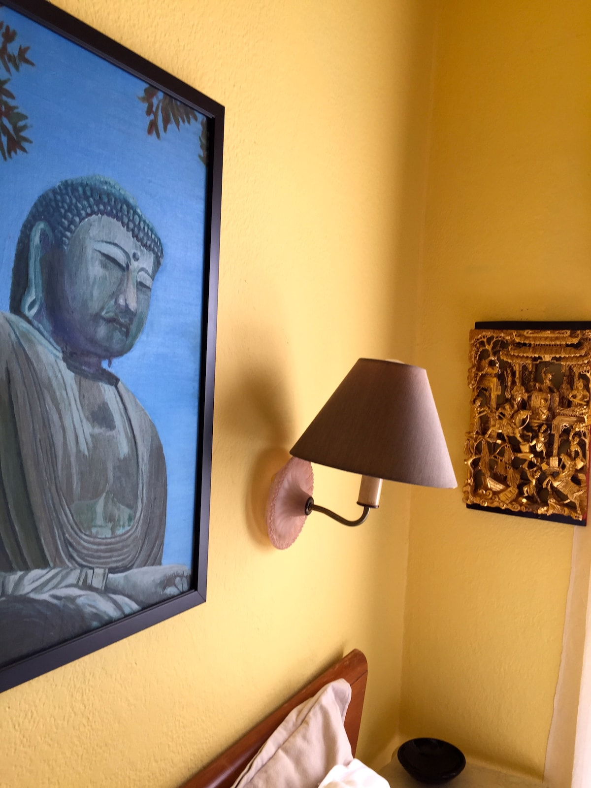 Buddha over the bed.