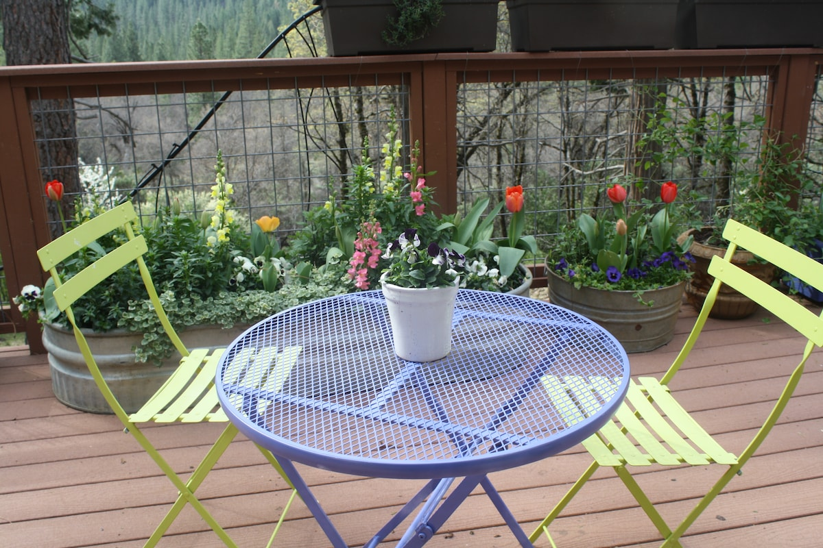 """Beautiful deck with amazing views.   """"The deck is absolutely amazing--a great quiet spot to enjoy a cup of coffee and read a book in the mornings."""" Airbnb guest."""