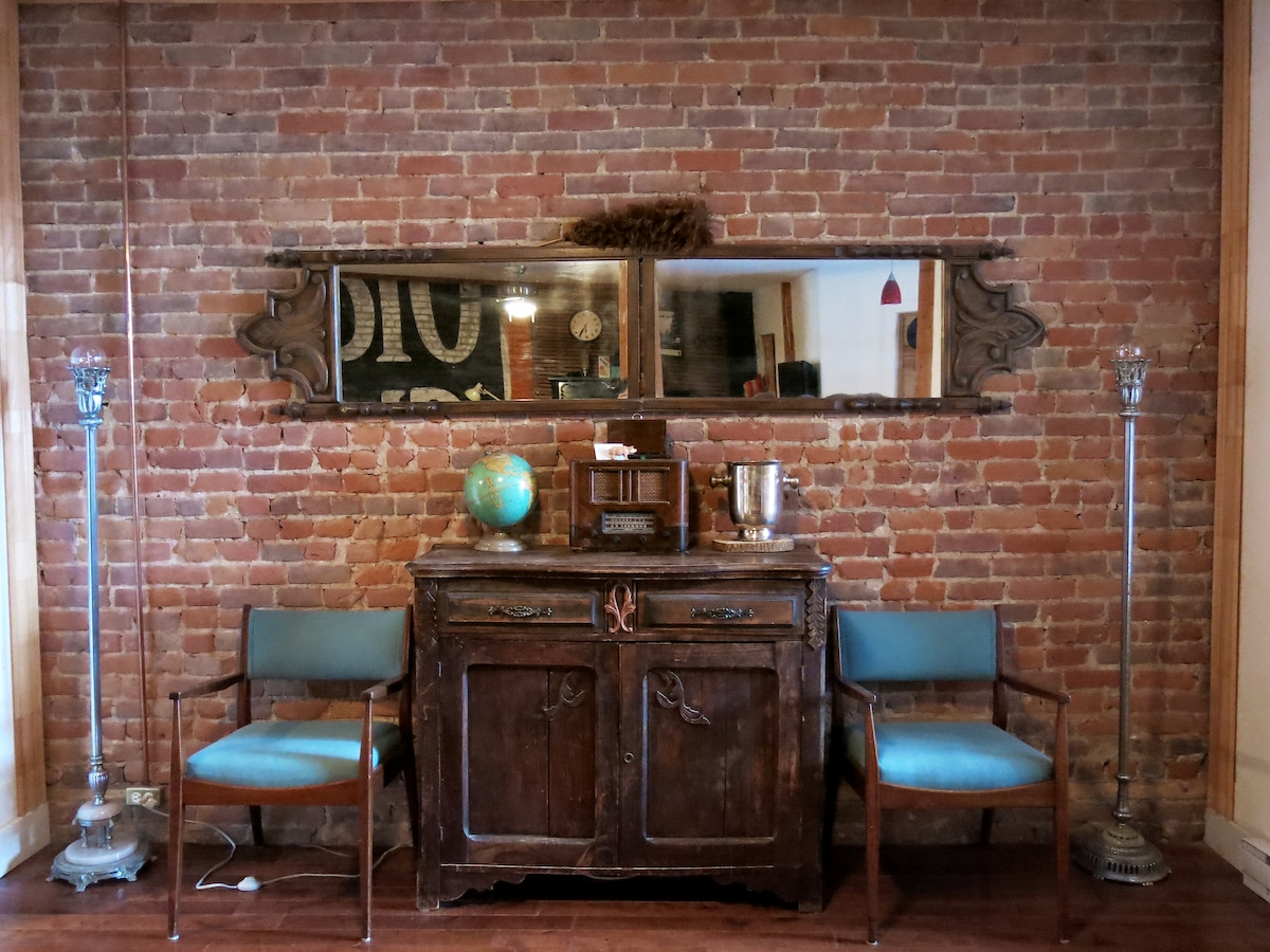 exposed brick wall in the dining room.