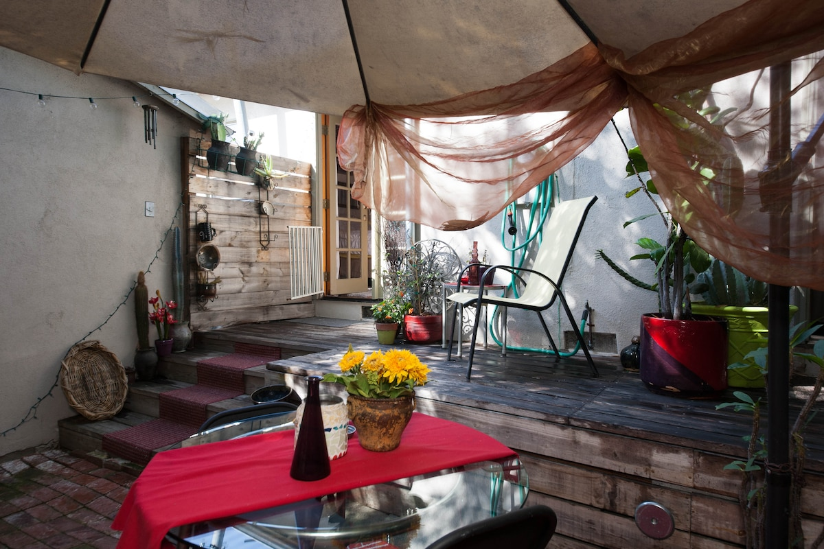 Your private Brick & Bamboo patio from under the umbrella.