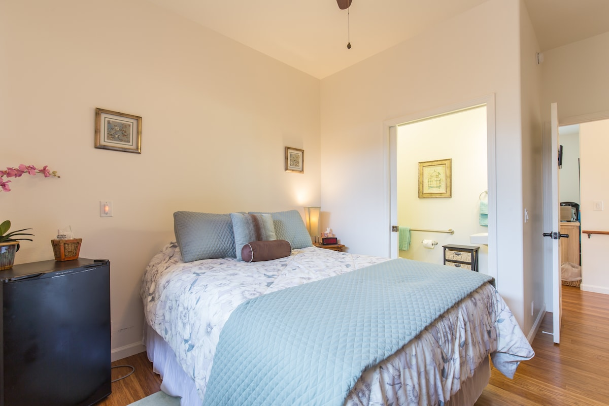 Plumeria room is equiped with comy queen bed, refrigerator, private half bath