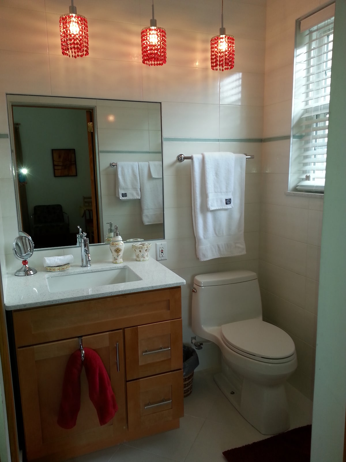 The bathroom clean & modern with lots of fresh towels.
