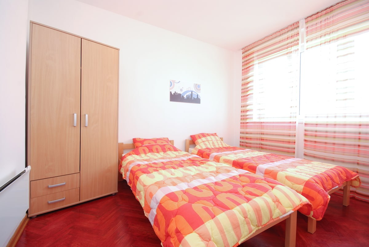 Bedroom with 2 single beds, if you are couple just get them together....
