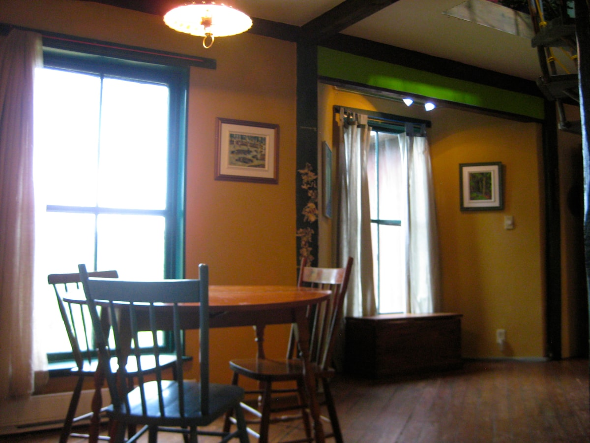 Kitchen nook and dining area- the window overlooks the lake at the foot of the hill