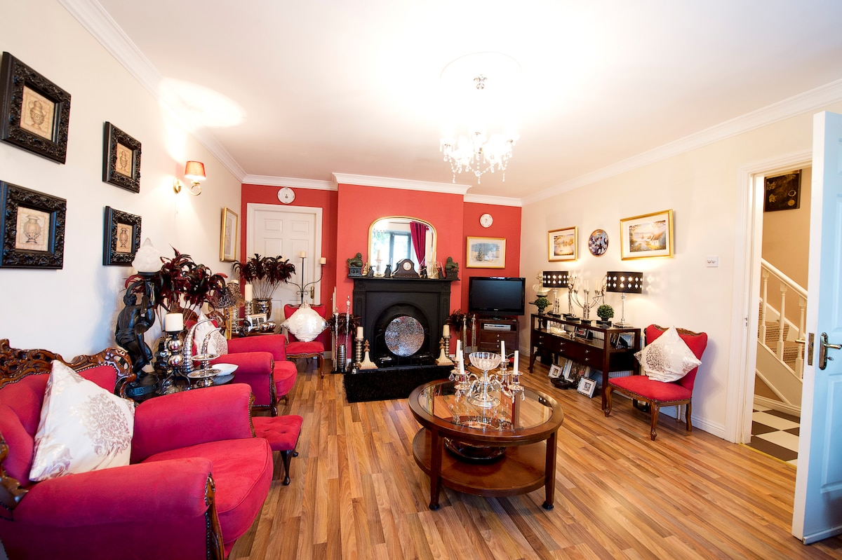 lounge with open fire place and lcd tv
