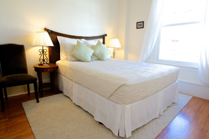 First bedroom with queen size bed.