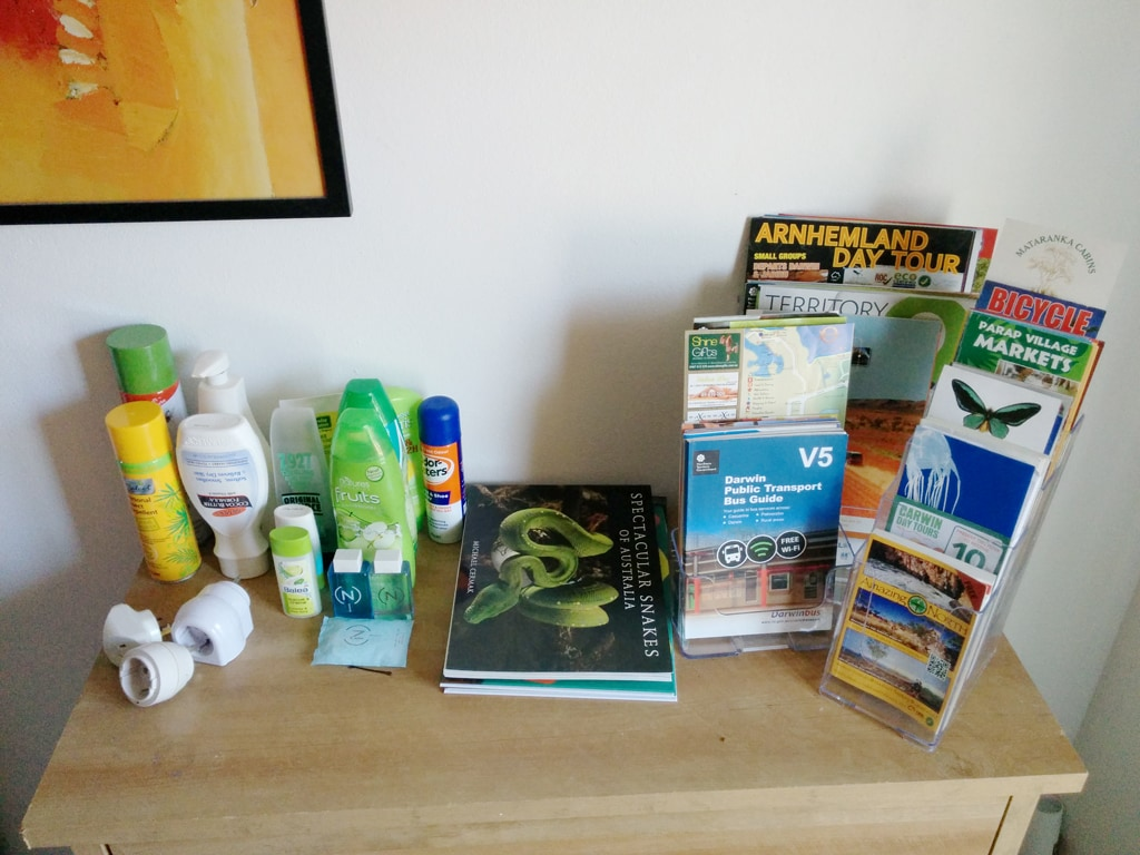 Some of the brochures, shampoos, adapters and other items available to guests.