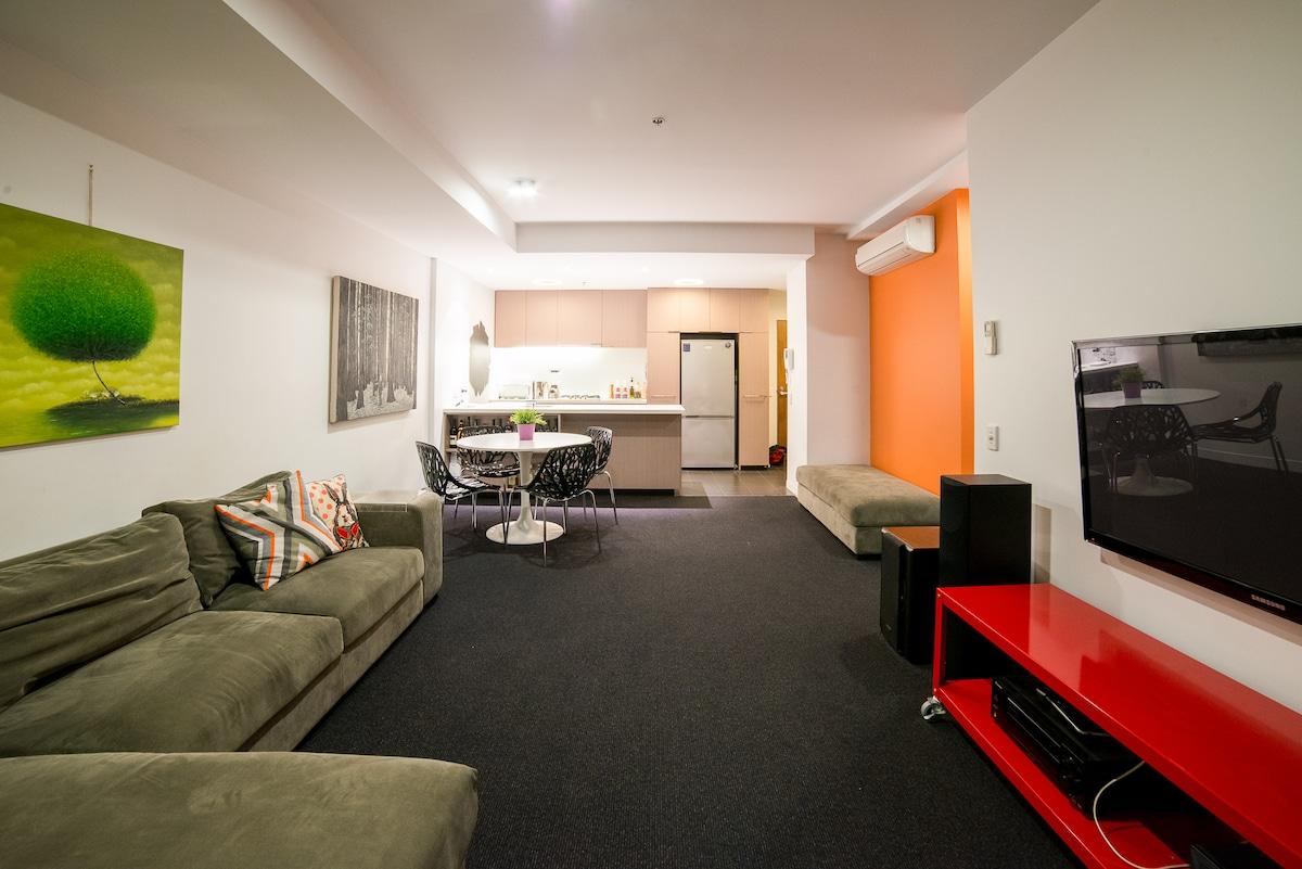 V comfy bed in designer apartment