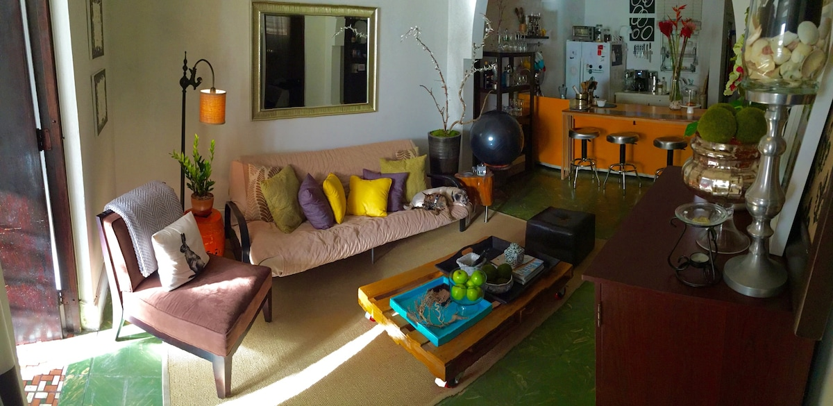 Comfortable living room and kitchen. 12 ft. high ceilings