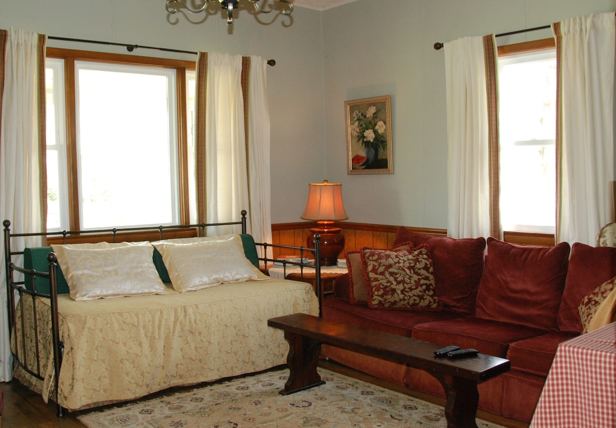Spacious living room also includes a day bed and trundle.