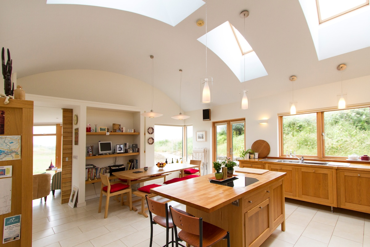 Kitchen / dining area is full of light, and looks out onto Croagh Patrick and the sea..
