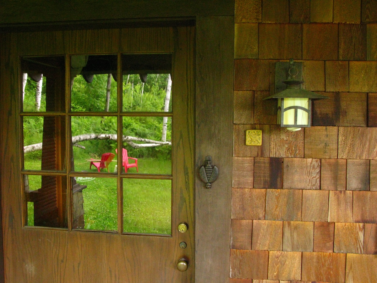 Our entrance reflects a field of white birches that surround our home.