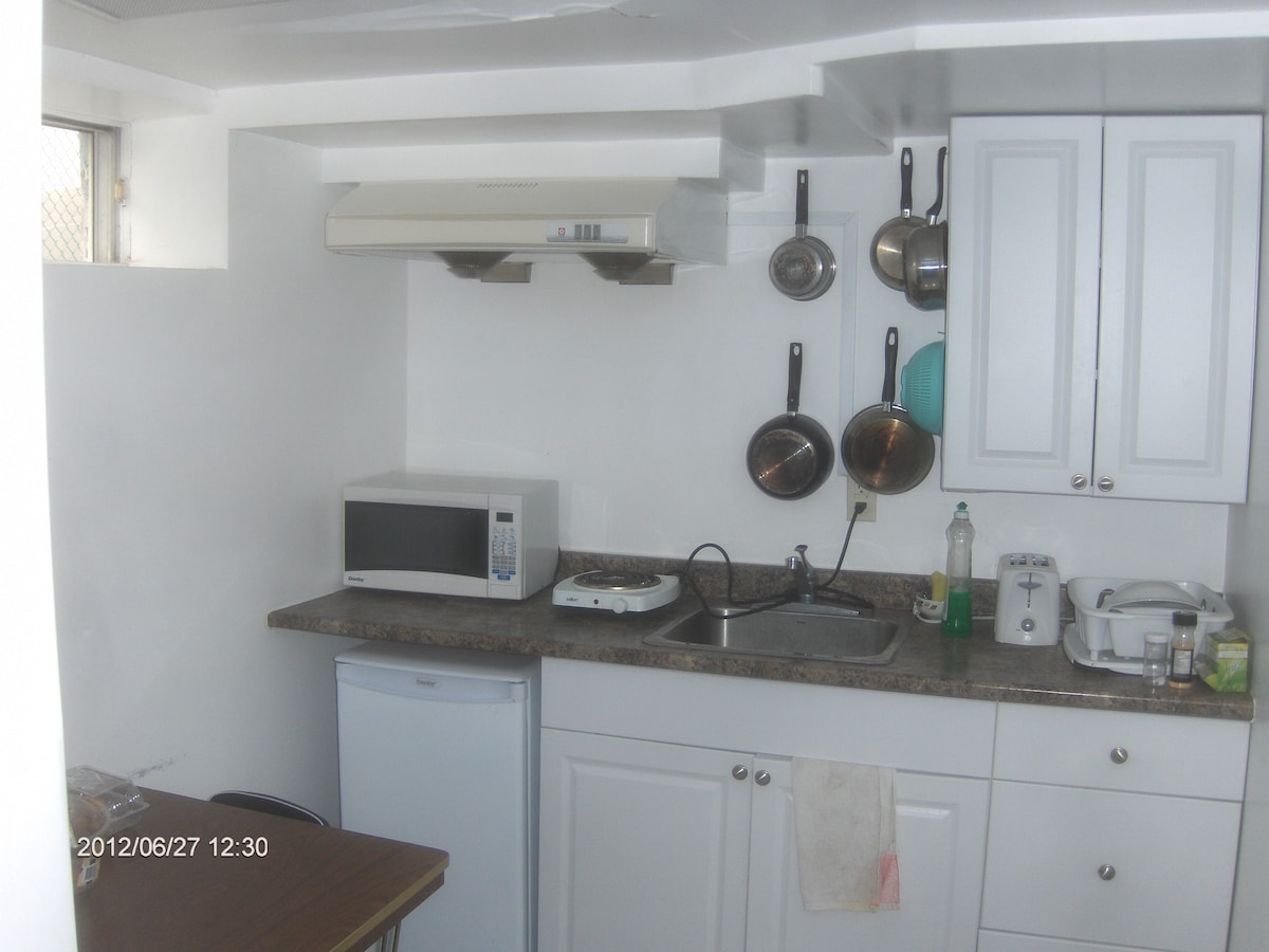 Kitchen shared with another room -has fridge,microwave, bread toaster, cooking stove for light cooking.