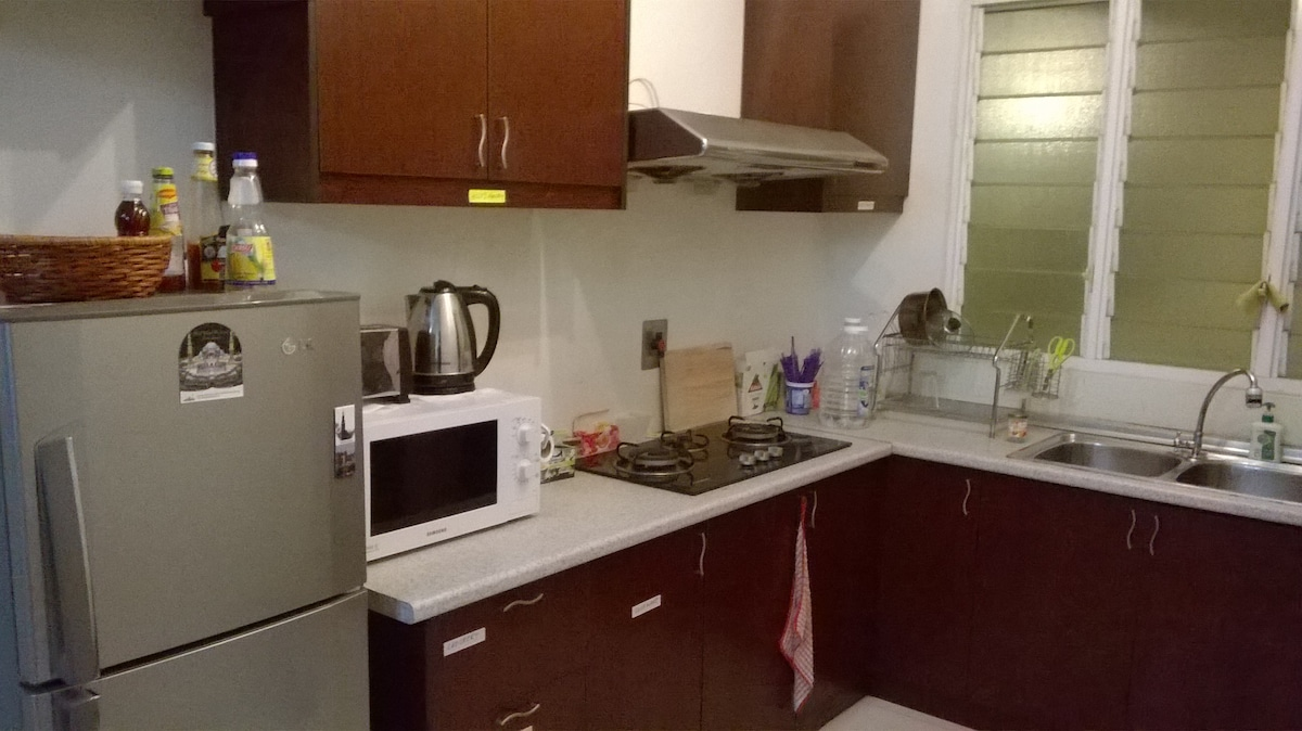 Kitchen comes with Fridge, Oven and Gas Stove for light cooking.