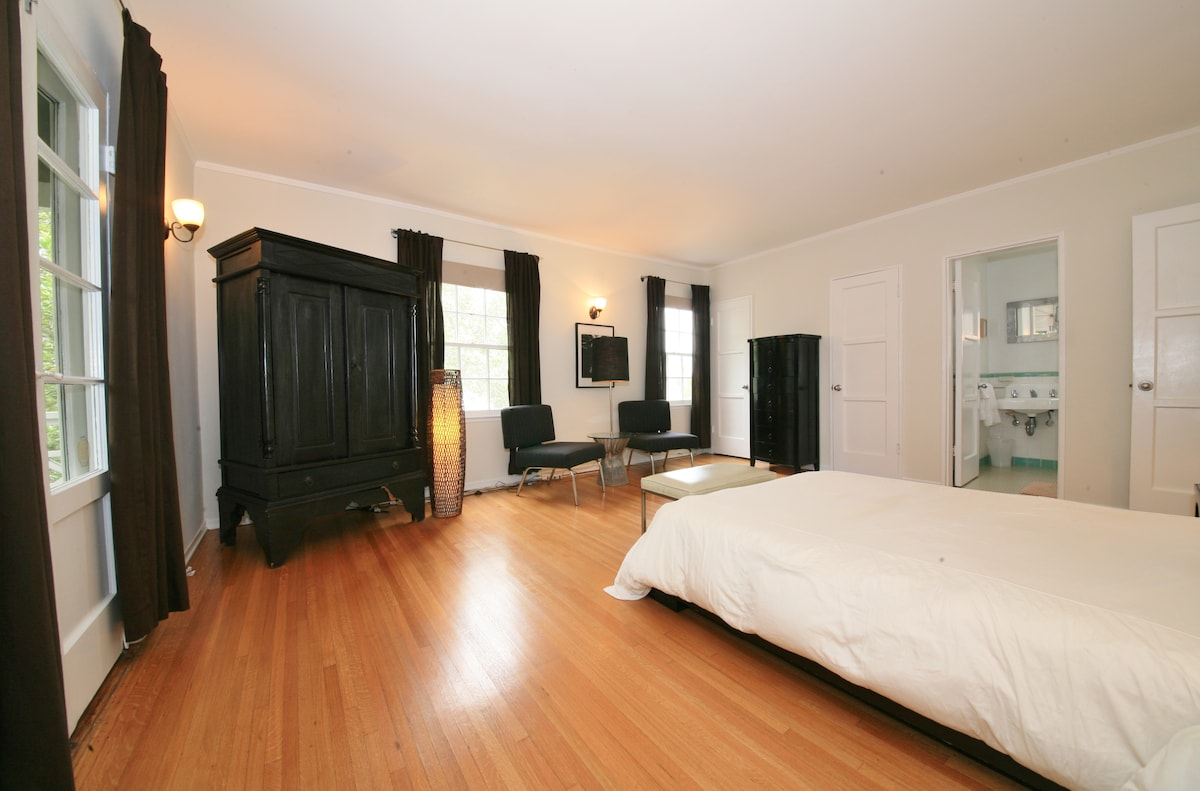The very large master bedroom.