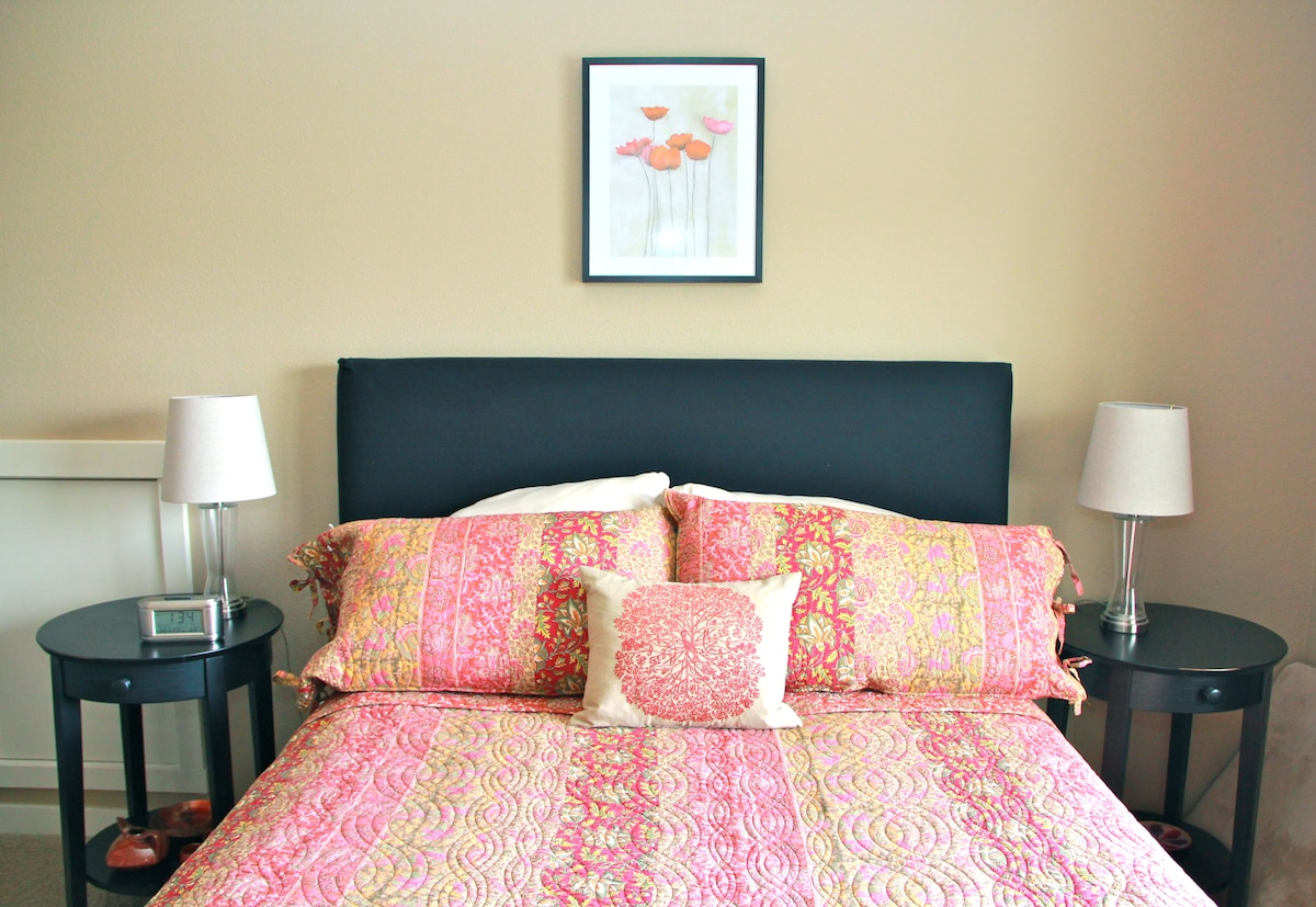 Welcoming, restful sleep in A Master Bedroom with Queen Bed.