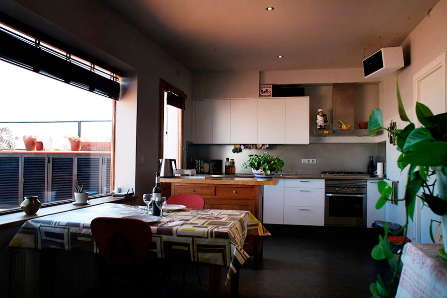 Kitchen/dining area near bay window overlooking the sky.  and dining room area.
