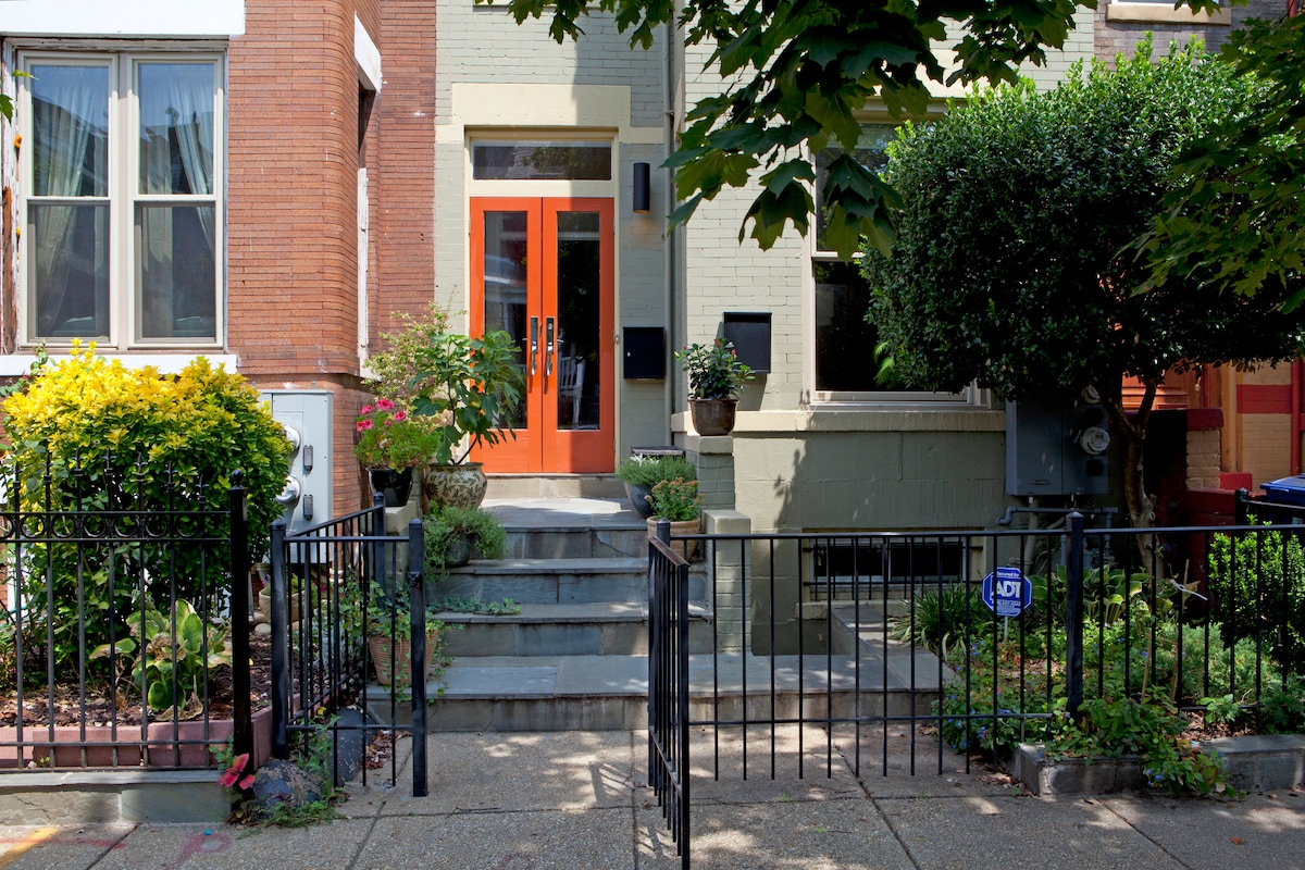 Our house is in the heart of vibrant Columbia Heights.  Note we've replaced the orange doors since this photo; they're now dark brown.