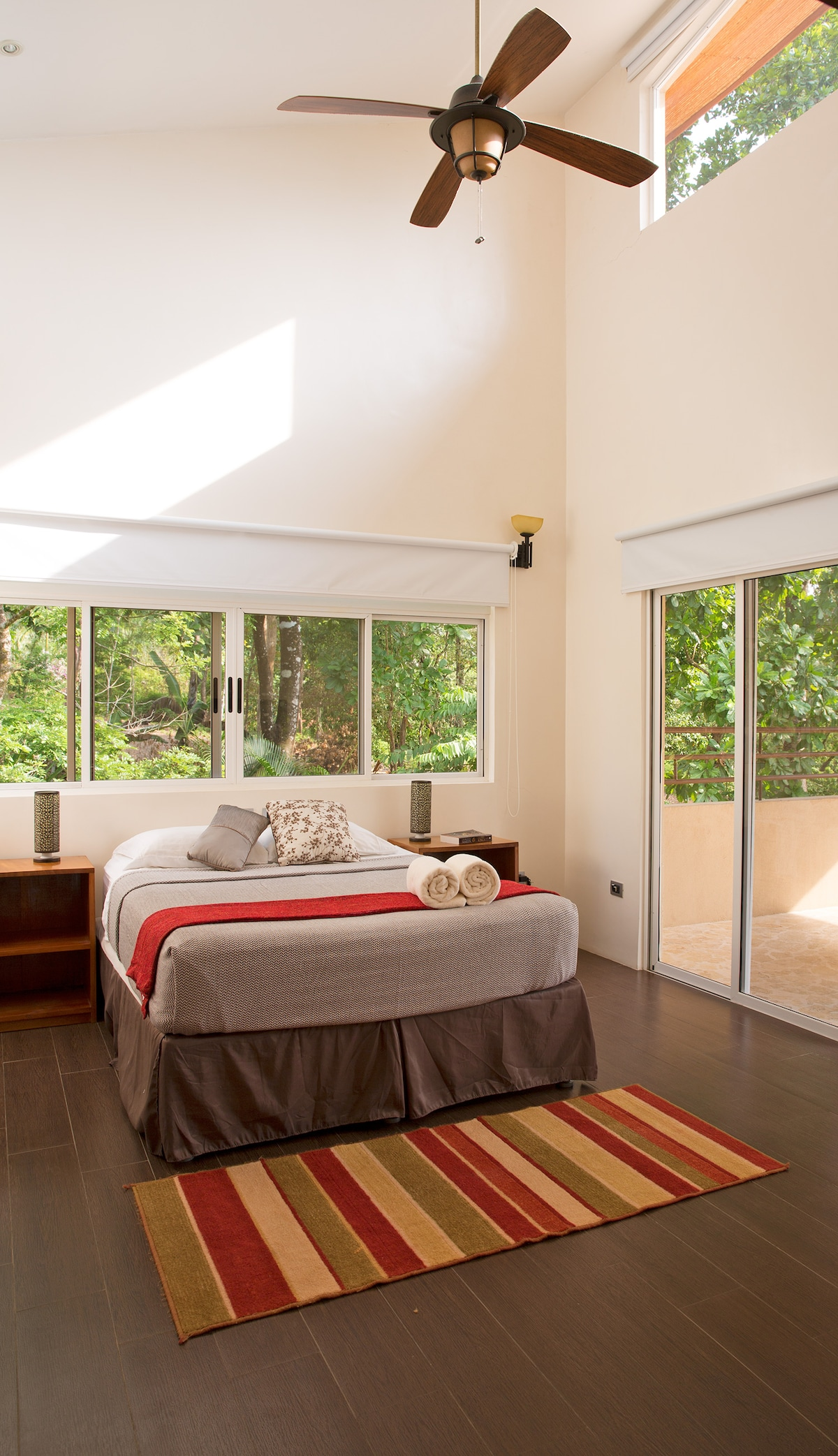 The second of two master bedrooms opens up to a dreamy tropical balcony.