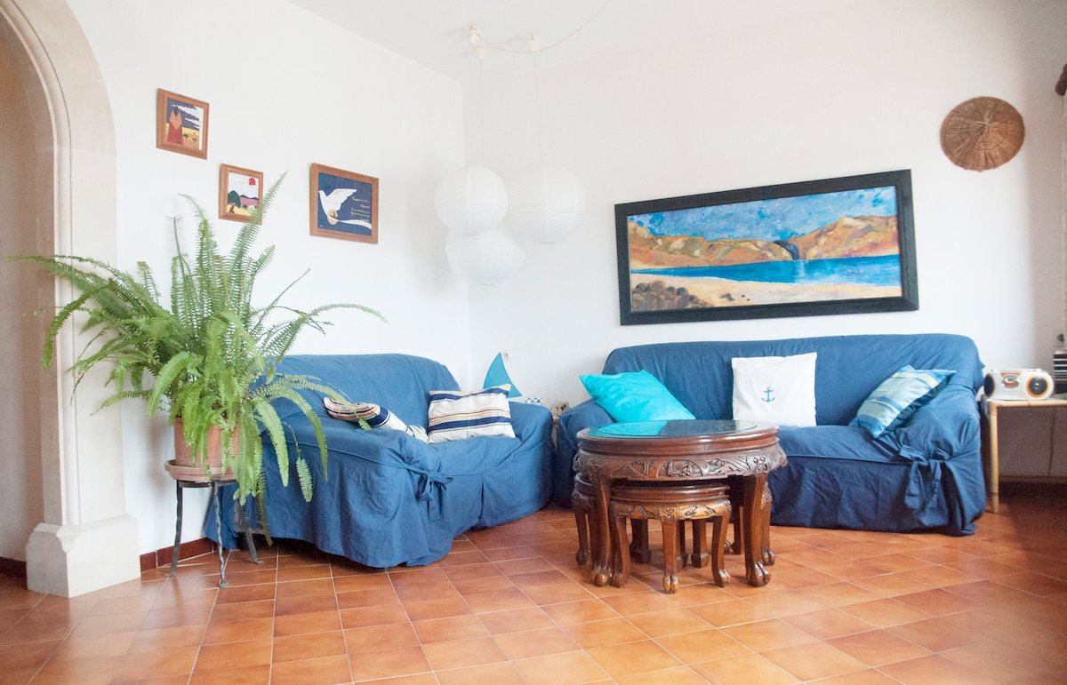 Living room with comfy sofa and sea view