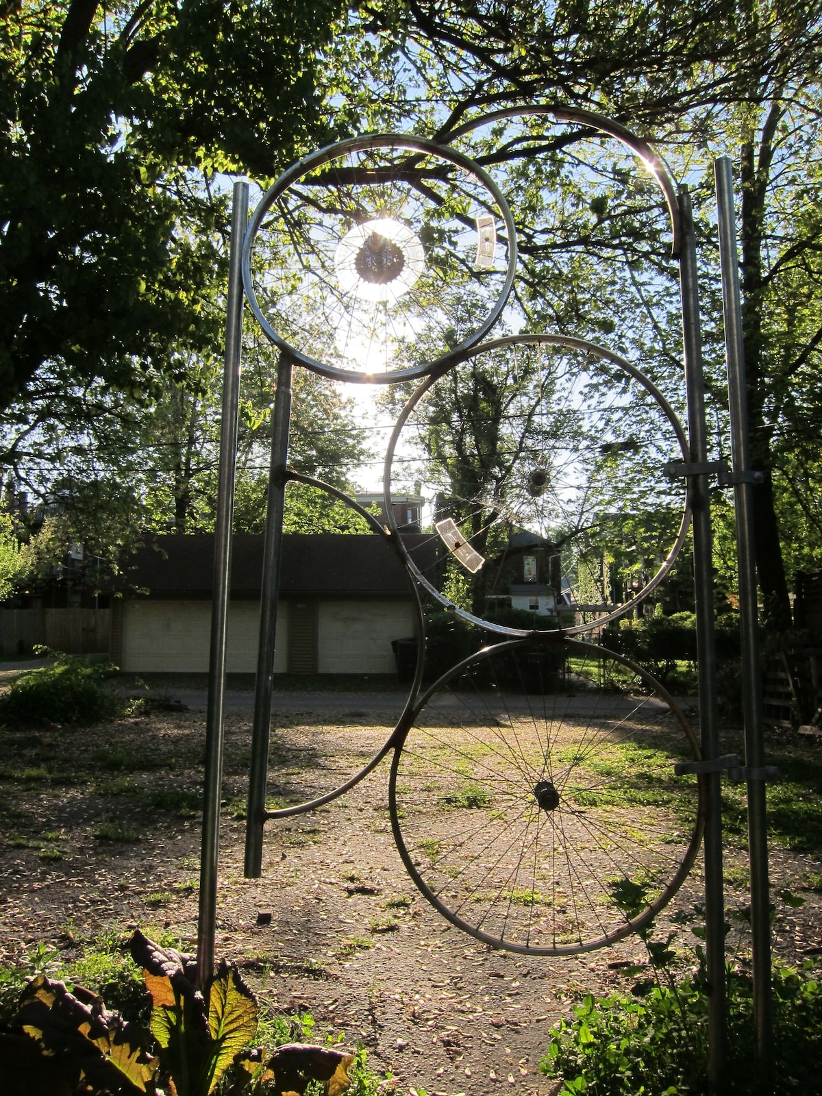 This hand-welded bicycle wheel gate was made by a friend. As you can see, the back parking lot is in need of paving. There is plenty of room for parking, though.