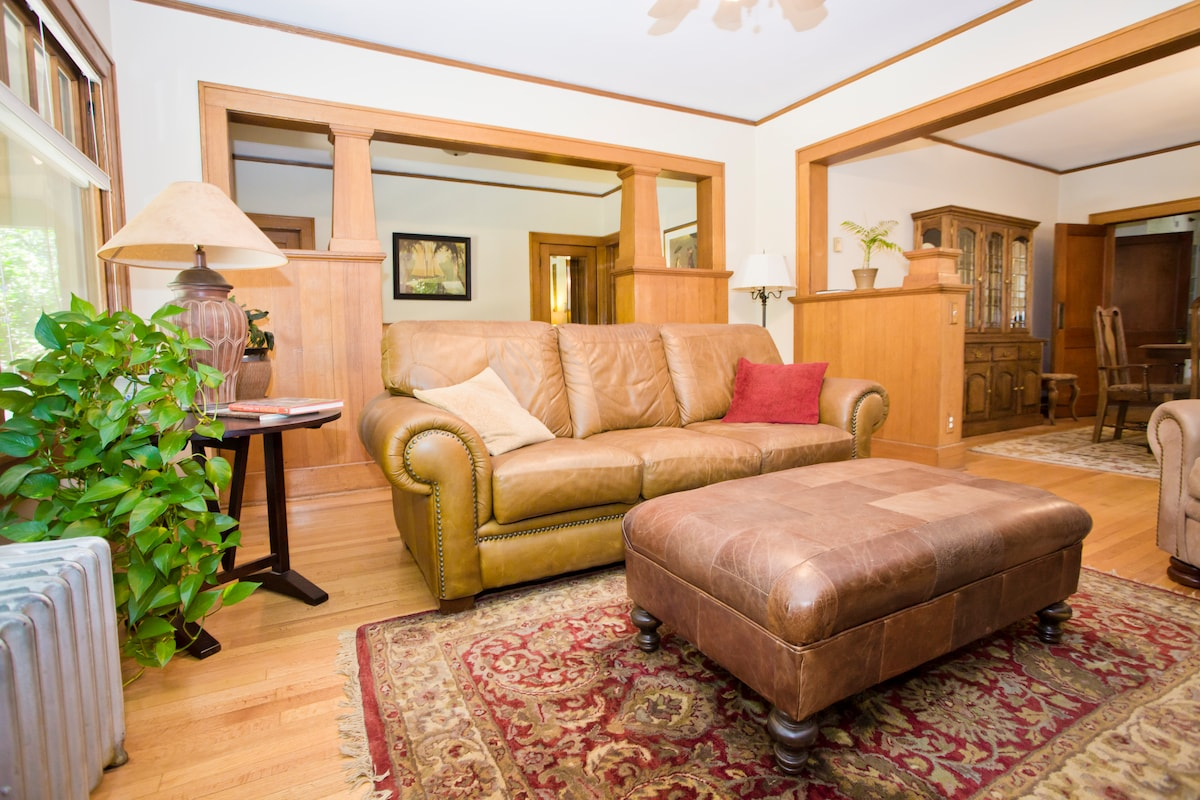 Beautiful craftsman bungalow with original hardwood floors, wood trim, built in book cases, character and charm!  Private suite - a bedroom with a comfortable queen size bed and updated full bath on the main level