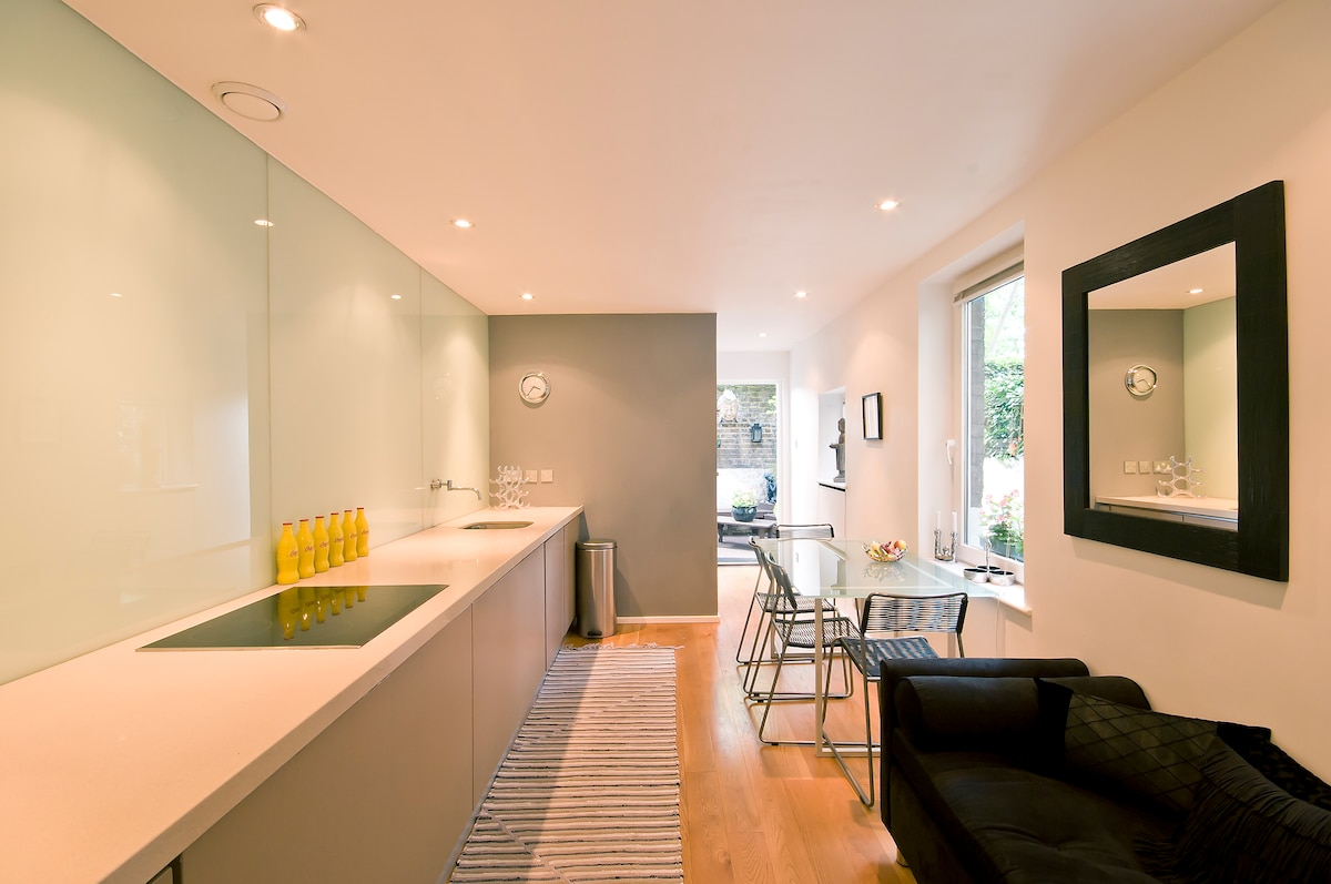 Kitchen with dining and french door to private garden