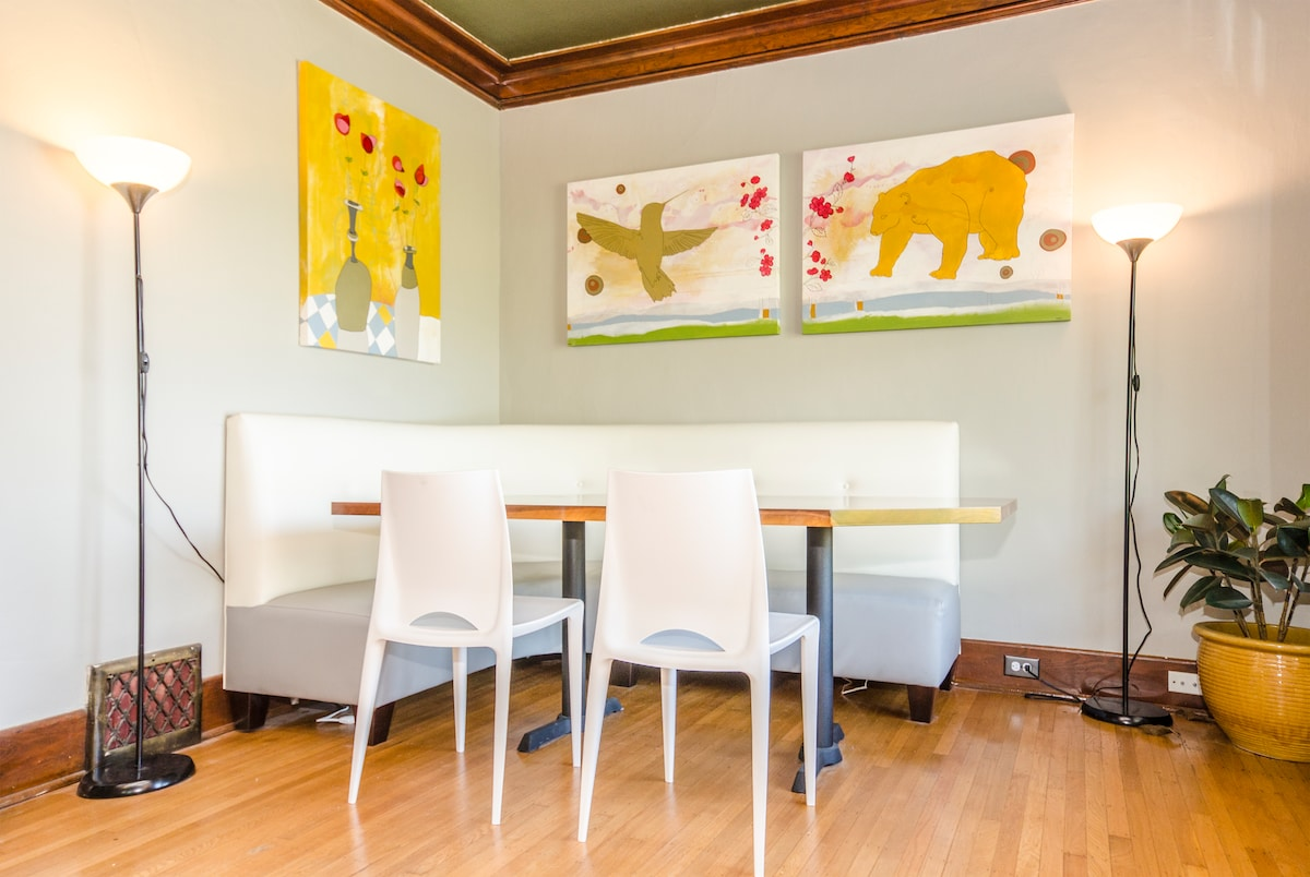 Dining area with custom booth and artwork - great for a relaxing dinner