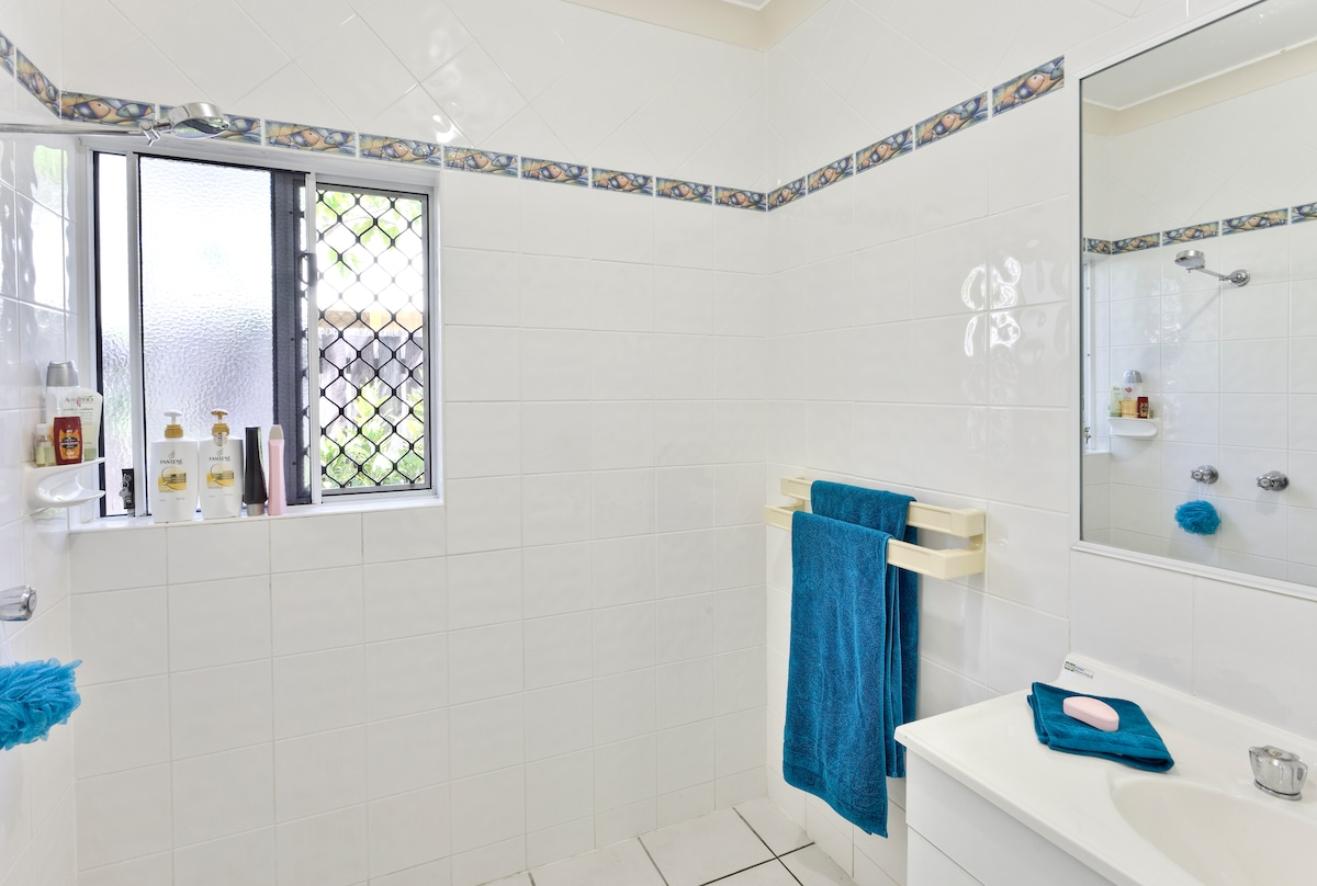 Your bathroom with complimentary shampoo, conditioner, soap and body wash. And fresh towels.