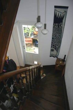 This is the entrance - your apartment is on the first floor. I got a bit carried away and started carving the bannister...