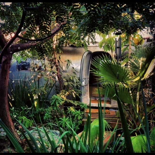 Looking across the garden to the Airstream. Photo courtesy of Marc Silver. (website hidden)