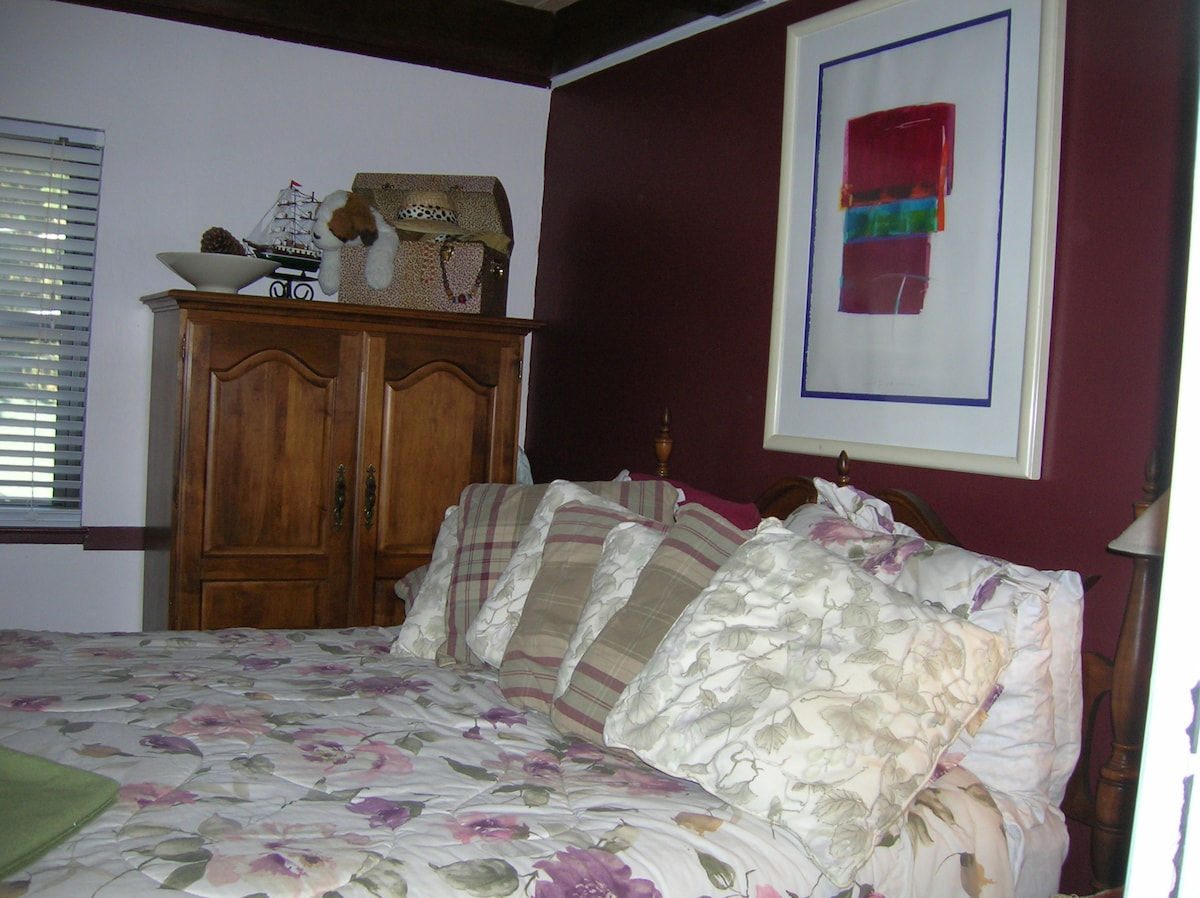 Bedroom has comfortable throw pillows and an extra blanket.