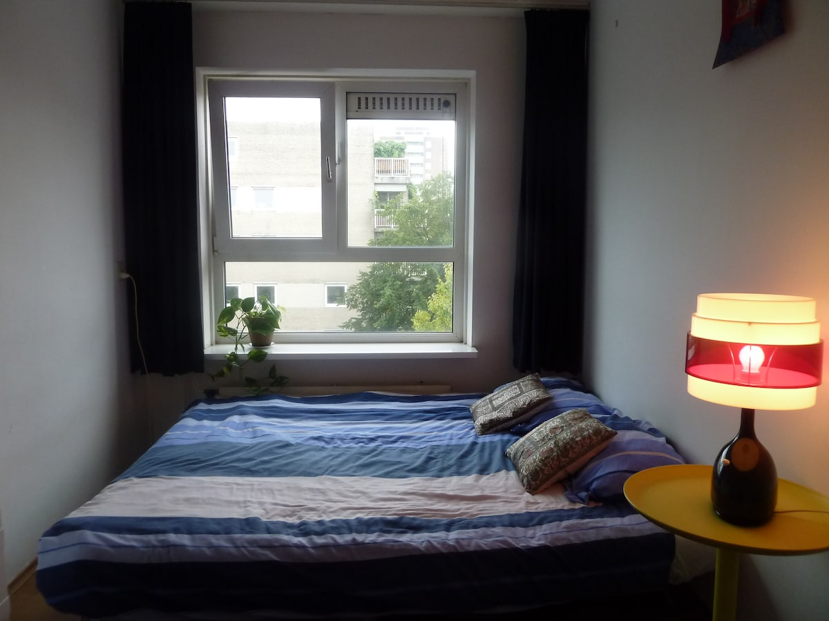 Room with bed and window