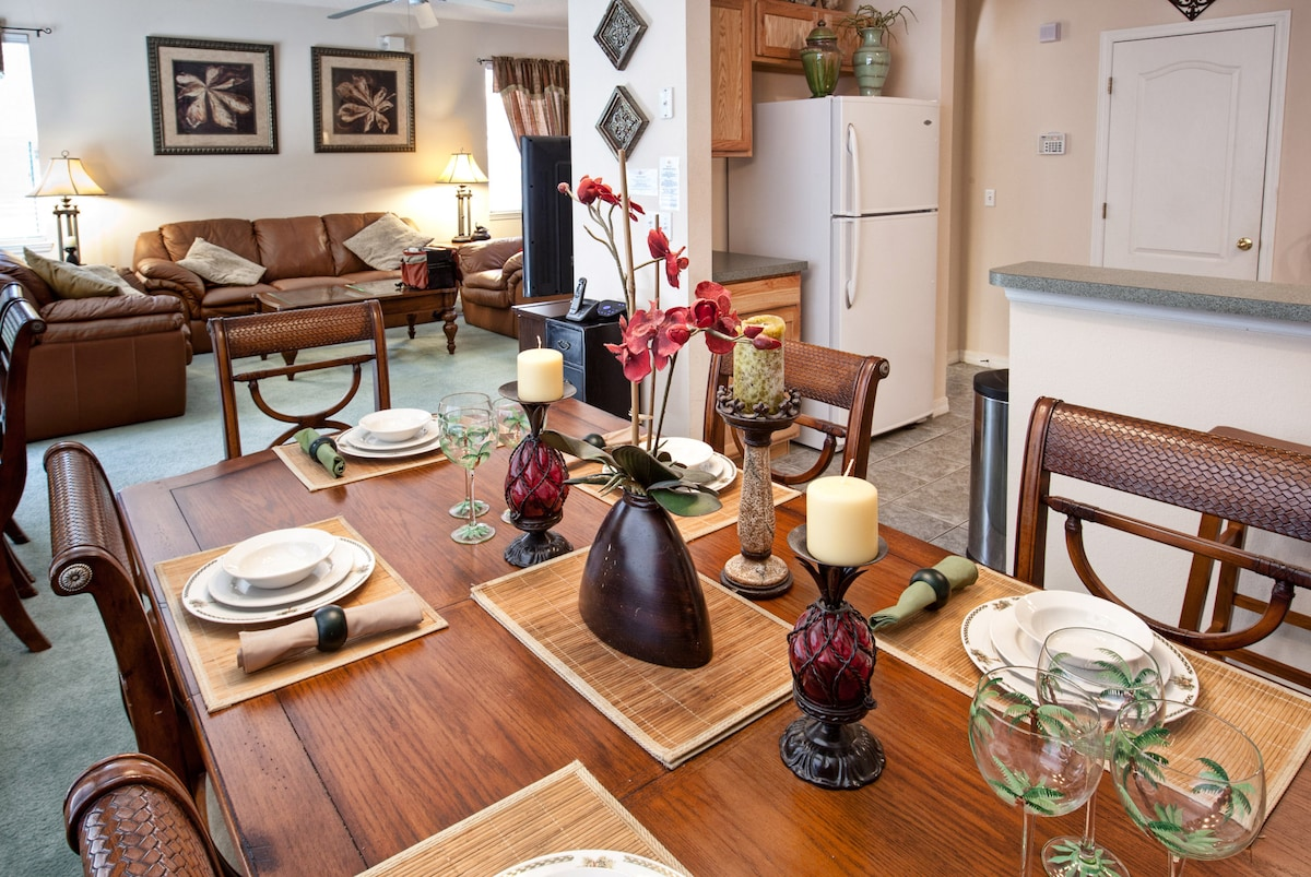 Decorated dining room connects to high tech living room and fully equipped kitchen