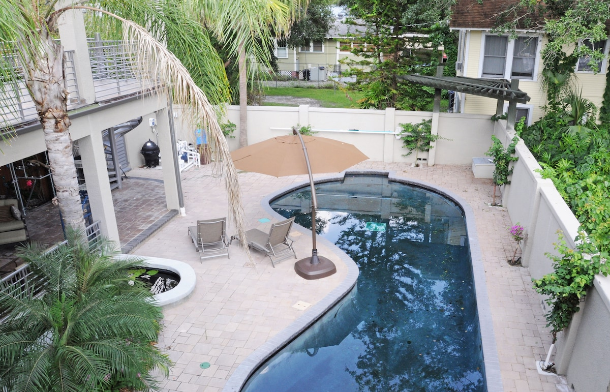 VIEW FROM ONE BALCONY TO THE POOL AND BACK YARD