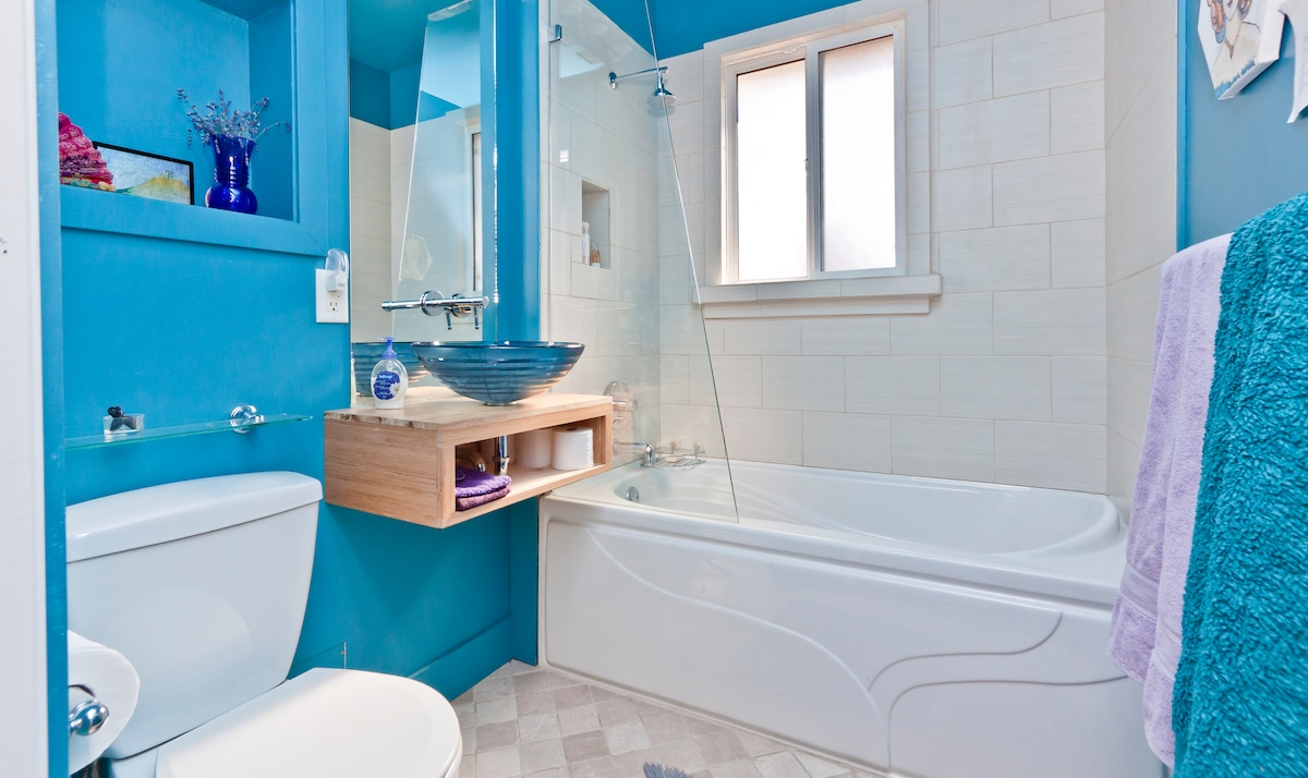 newly renovated bathroom with bath or shower, heated floor. private if only one room booked, shared if both rooms booked but only for guests. host has own bathroom.