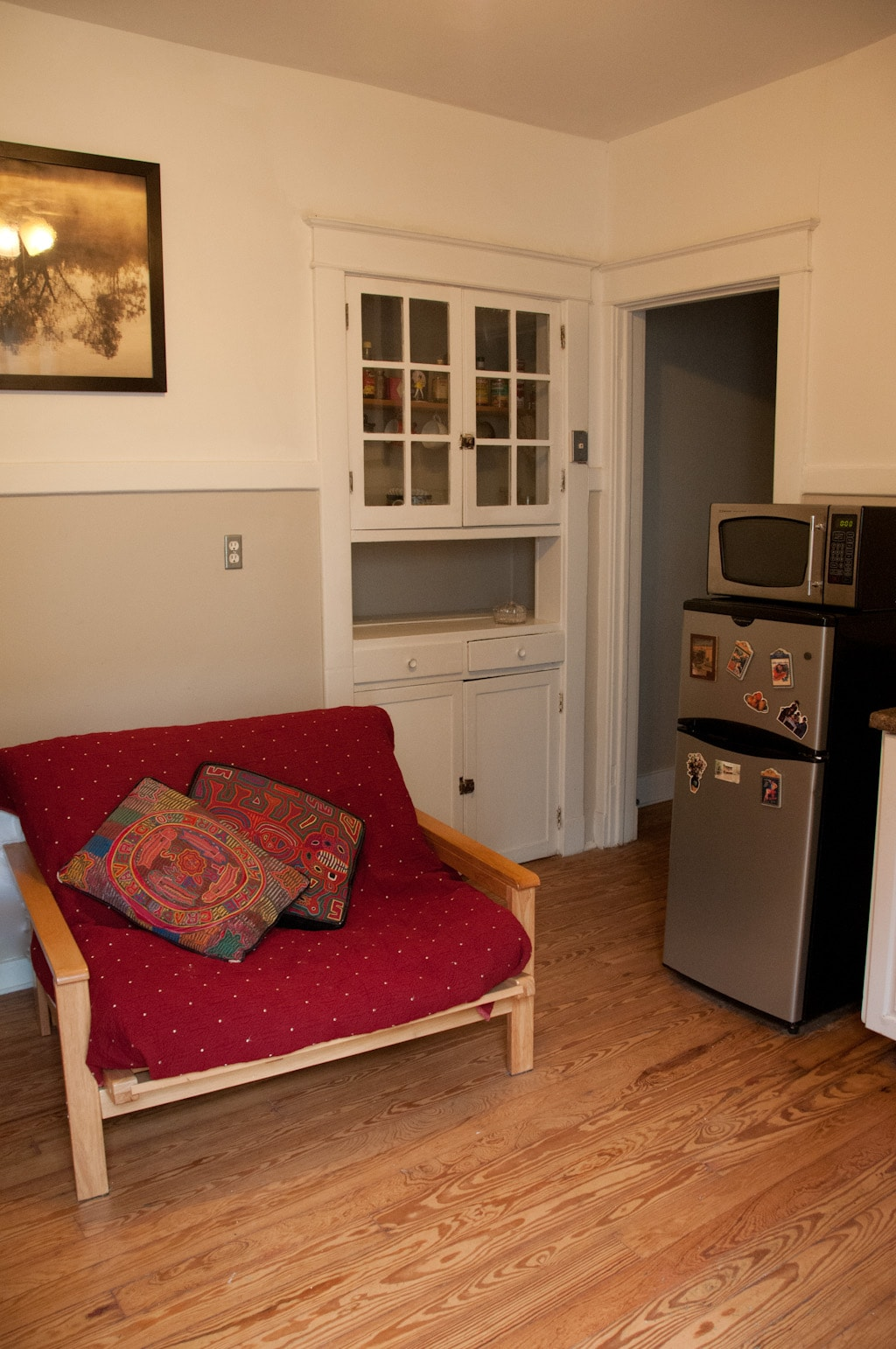 Fold out twin futon couch bed, super comfy with studio fridge and microwave, cupboard filled with necessities
