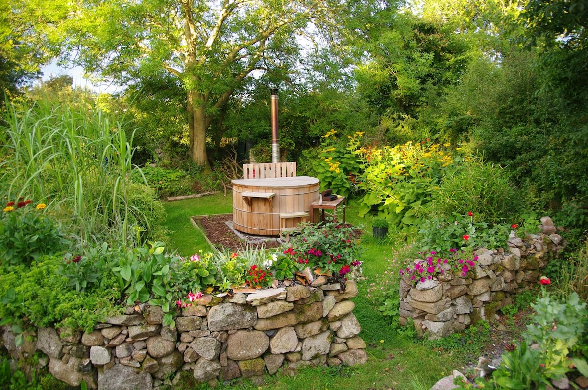 The wood-fired hot tub in the Round Garden, around the back of Tullyquilly Cottage.