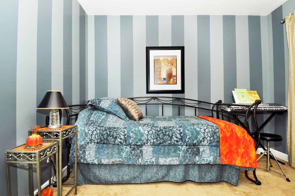 Grey Guest Room with twin size bed.