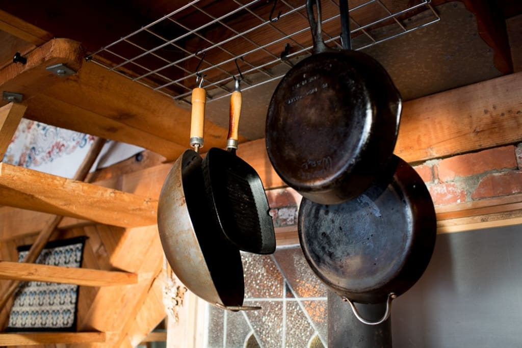 More kitchen supplies hang over the woodstove