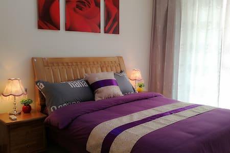 桂林七星区学府家庭温馨公寓双卧套房 - Leilighet