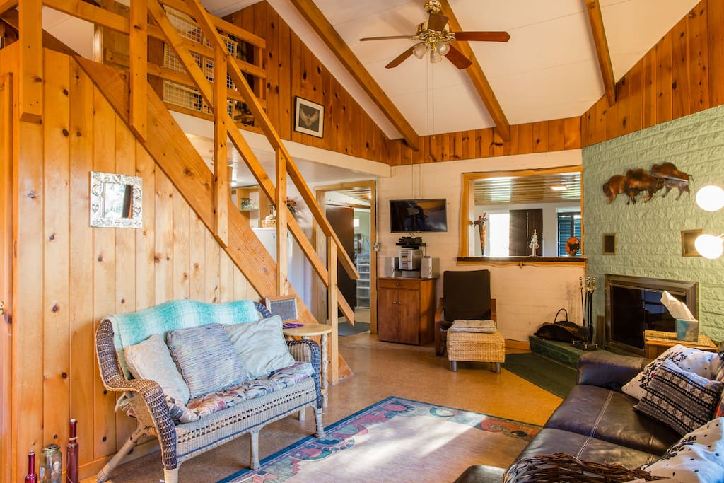 Enter to cozy cabin l.r. You can move wicker settee to fireplace or tv viewing.