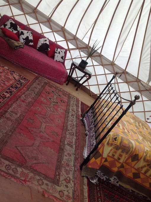 Yurt with double bed and sofa